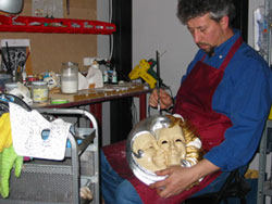 One of our mask makers at work